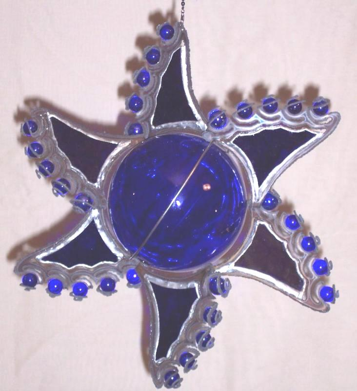sun burst with cobalt blue stained glass, ball, & marbles