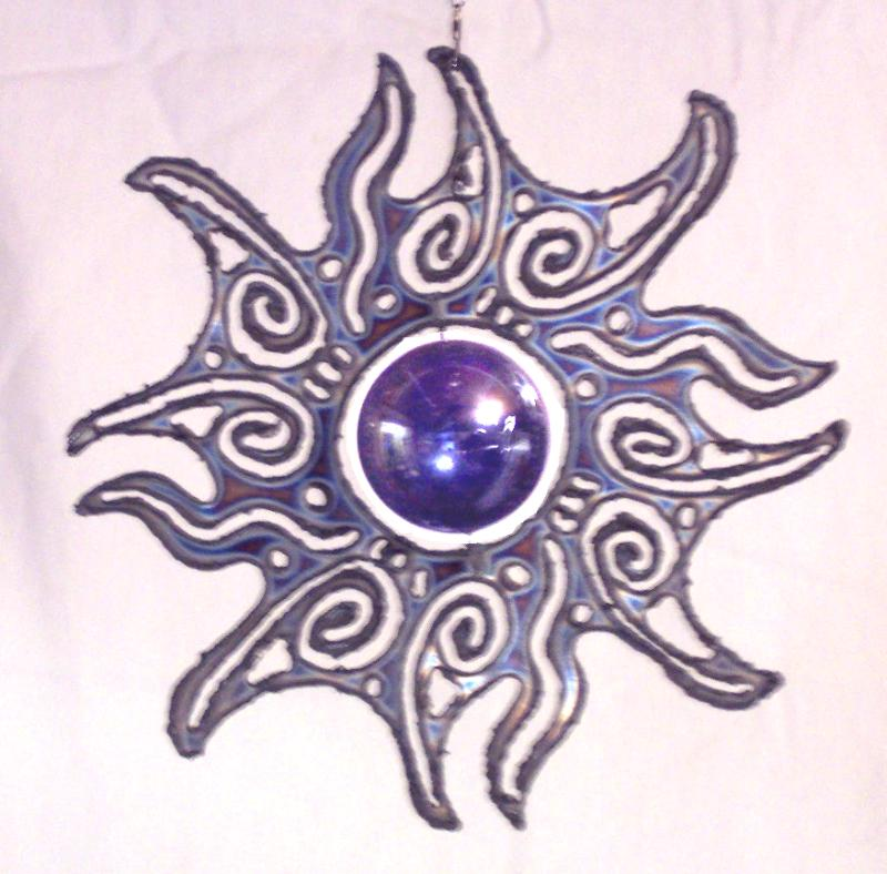 stainless steel sun burst with blue spinning glass marble